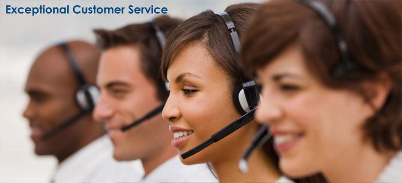 four customer service representatives assisting customers over phone